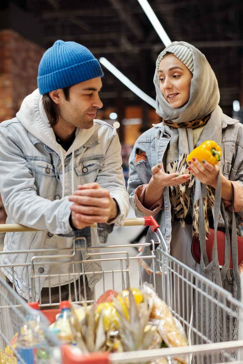 happy couple shopping at a supermarket